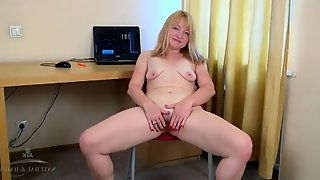 Milf plays with her bush in a hotel room