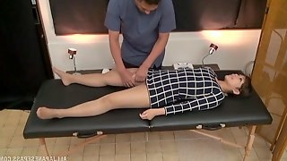 Naughty masseur oils up his hot client and then fingers her cunt