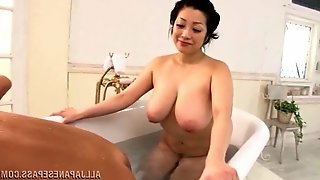 A busty Japanese MILF blows a guy and tosses his salad